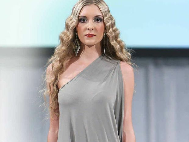 Gympie's Annie Potter, on the catwalk at Fashion Week, could become the Face of International Fashion Week.
