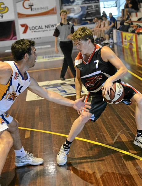 Point guard Hayden Wicks looks to evade the defence playing for the Mackay Meteors in the Queensland Basketball League.
