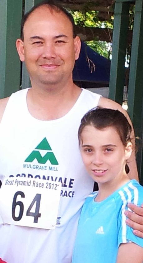 TALL TASK: John Wieden with daughter Tamiesha ahead of the start of the Pyramid Race last year.
