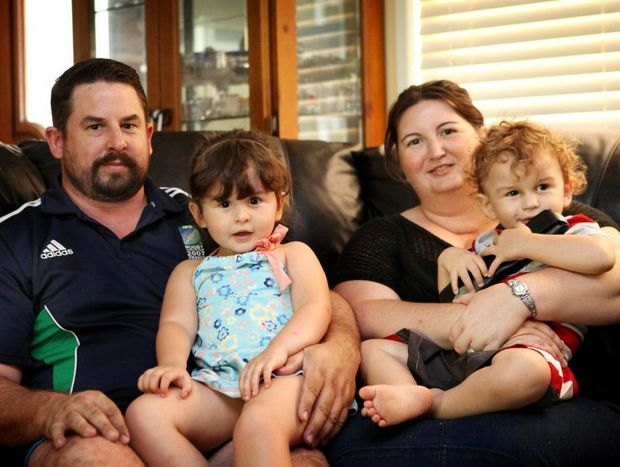 Dino and Rachel Tellan, with their children Jessica, 3, and Sam, 2, are happy the relocated to Rockhampton.