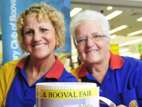 FOR THOSE IN NEED: Booval Rotary member Glennis Bentley (left) and helper Julia Keidge collect donations at Booval Fair for families affected by the bushfires.