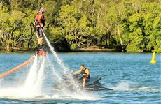 ALL POWER TO HIM: Maroochy River Jet Ski Hire owner Jamie Hetherington puts on a flyboard demonstration on the river yesterday.