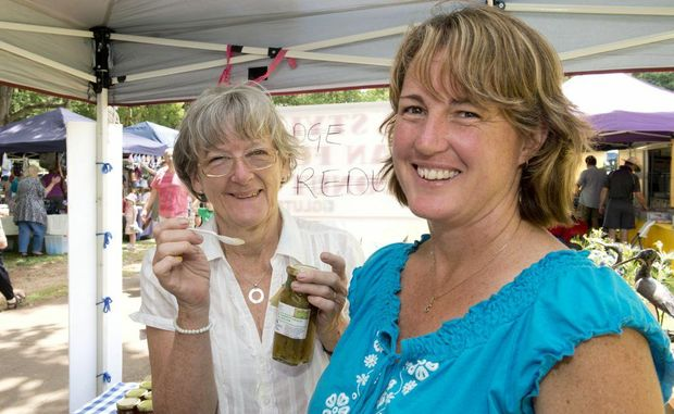 Vendors Stephanie Piers (left) and Samantha Douglas take time out yesterday at the markets.