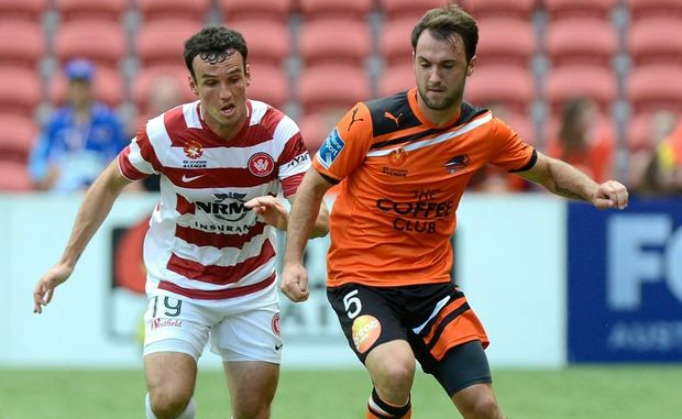 Ivan Franjic of the Roar is pressured by the defence of Mark Bridge of the Wanderers during the round seventeen A-League match between Brisbane Roar v Western Sydney at Suncorp Stadium on January 20 in Brisbane.