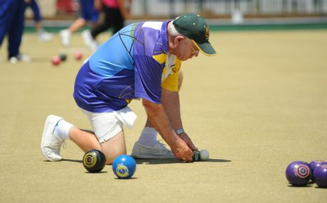 SO CLOSE: Dusko Zobenica measures for the shot during a bowls match between the Burnett Bowls Club and Hervey Bay. Photo: Mike Knott / NewsMail