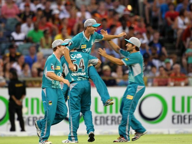 Nathan Hauritz is hoisted in the air by his Brisbane Heat teammates after catching out Perth's Shaun Marsh during the Big Bash League T-20 final.