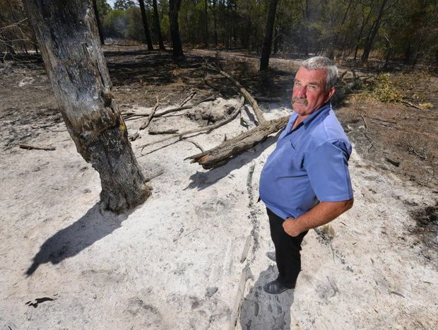 SCRUB FIRE: Dale Clarey is angry after vandals set light to a Coonarr property. Photo: Scottie Simmonds / NewsMail
