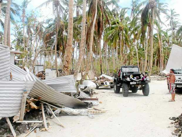 DIRECT HIT: Some of the damage in Samoa after Cyclone Evan struck last month.