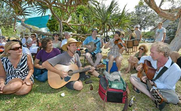 Jay Bishoff performs with friends at the Peregian Originals' Supporters Picnic at Peregian Beach Park.