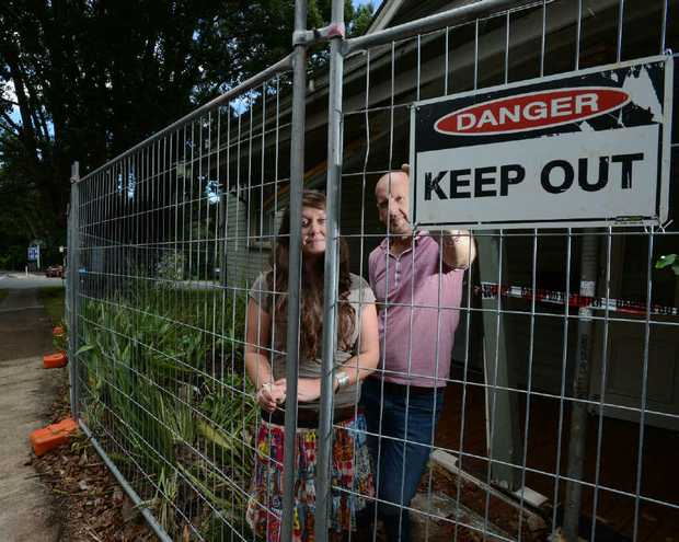 DOWN TO THE WIRE: Zoe Robinson-Kennedy and Peter Wood from Arts Northern Rivers outside the building they work in, damaged when a car ploughed into it earlier this month.