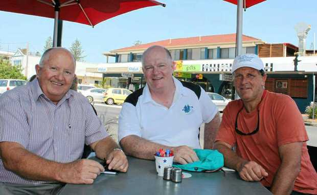 Yamba SLSC president Alan Schofield discusses the River Odyssey with Alex Abrahams and Richard Bennett. PHOTO: CONTRIBUTED