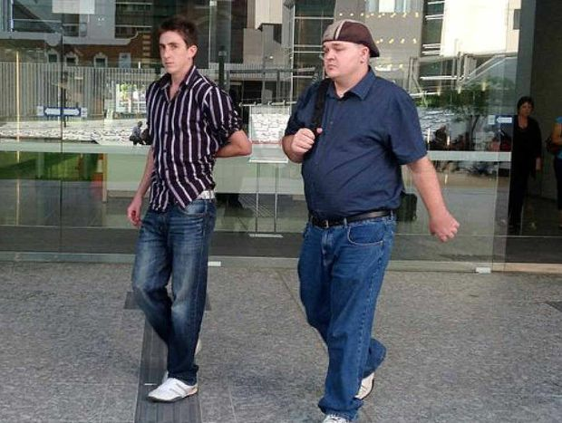 Stabbing victims Rodney Michael Pettitt (left) and Robin Neville Drury leave Supreme Court in Brisbane.