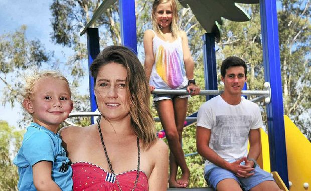Melissa Clegg, of Aroona, holding son Billy, 3, allows elddest son Jimi, 15, to supervise daughter Ruby, 9, in their neighbourhood.