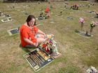 Cemetery halts ban on tributes on children's graves