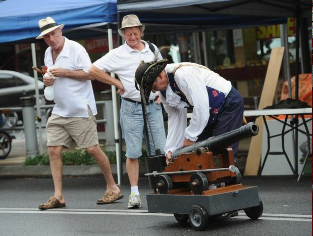 Town crier Ken Ashford prepares the cannon for the one o'clock firing at the Maryborough Heritage City Markets.