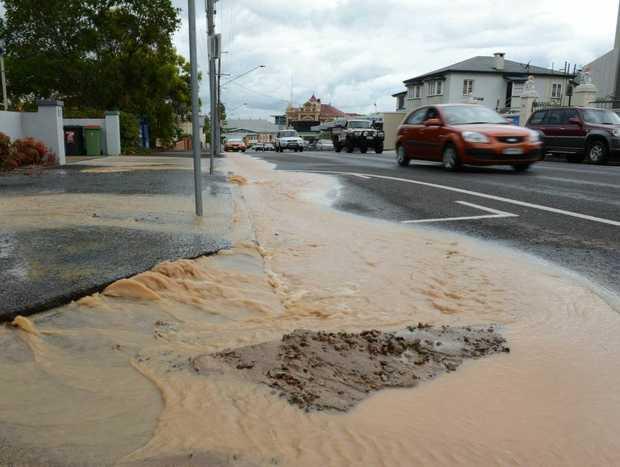 A burst water main on Limestone Street, Ipswich on Thursday.