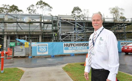 University of the Sunshine Coast Gympie campus manager Graham Young is pleased with progress on the new university building at Gympie TAFE.