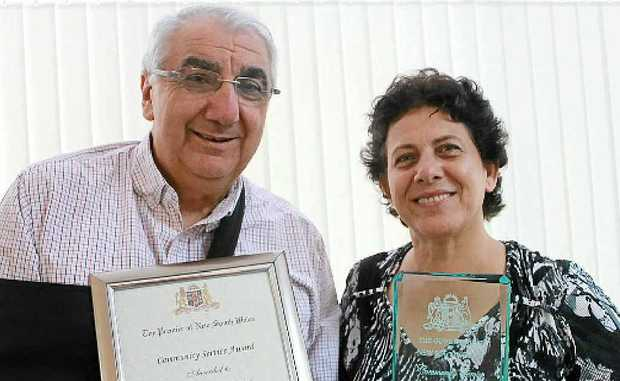 DEVOTED TO HUMANITY: MP Thomas George awards Dr Vahideh Hosseini a Premier's Community Service Award.