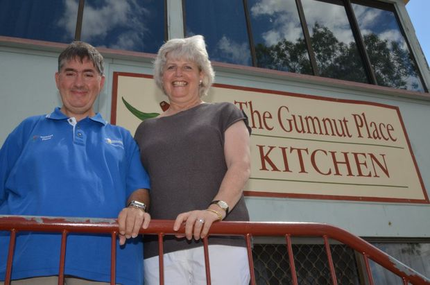 OPEN ARMS: Gumnut Place employee Chris Thompson with Nina Temperton.