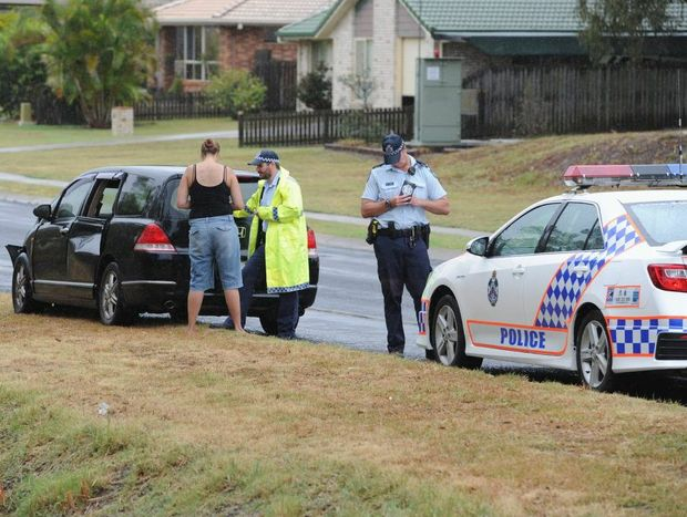 Police at the scene of a two-vehicle crash at the intersection of Bideford and Colyton Sts at Torquay.