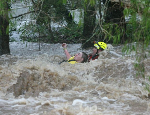 This dramatic rescue was captured by APN photographer Allan Reinikka from The Morning Bulletin in Rockhampton this morning. The weather bureau has predicted the rain depression from ex-cyclone Oswald will hit the Northern Rivers on Monday with forecast rainfall of between 300 to 400mm.