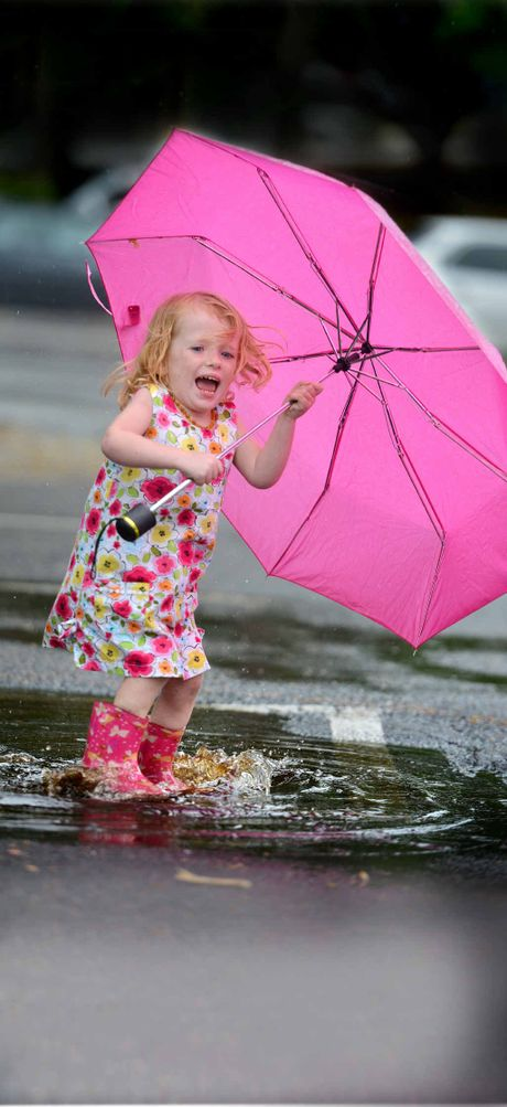 Little Emily Ross has fun splashing in puddles in Nelson Reserve car park yesterday.
