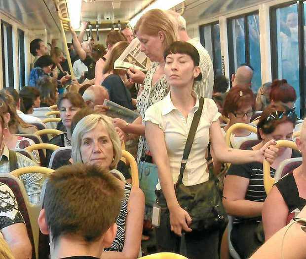 Commuters on a Brisbane to Sunshine Coast train on Wednesday.