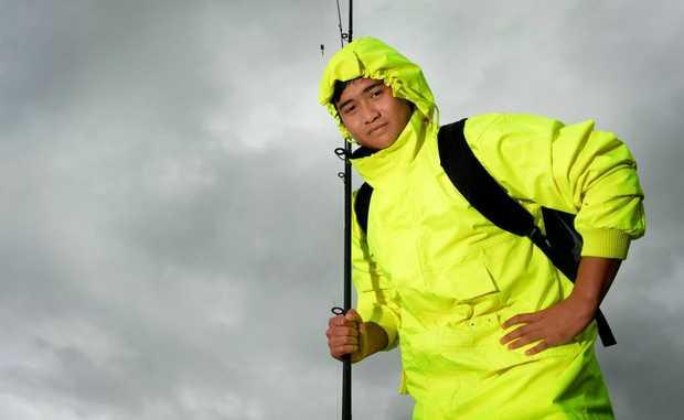 Australia day 2013. Louis Le goes fishing in the rain. Photo: John Gass / Daily News