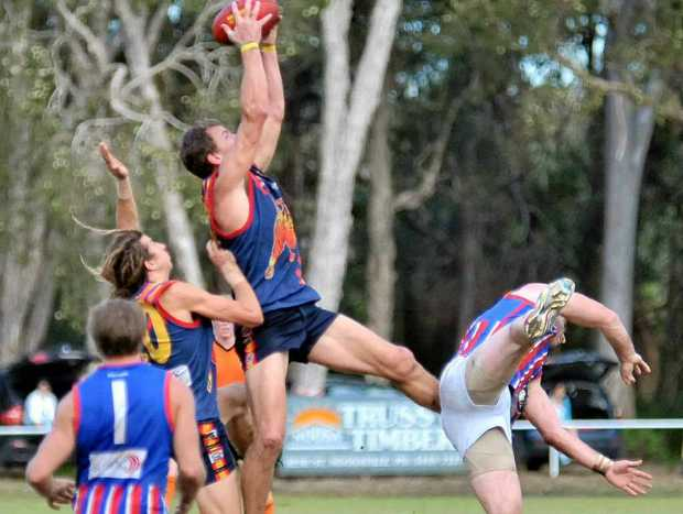 GREAT HANDS: Peter Trompf pulls in a screamer against Wilston Grange last season.
