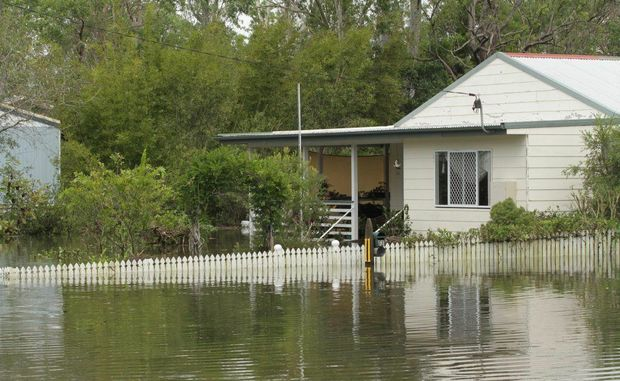 One of the houses in Aldershot taking in water midafternoon on Sunday. The high tide is expected to cause further inundation. Photo: Robyne Cuerel / Fraser Coast Chronicle