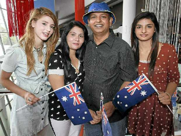 NEWFOUND PRIDE: New Australian Boaz Gill, from Pakistan, with his family – Shaffaf, 18, wife Amira and Aousaf, 16.
