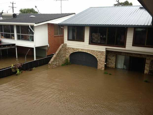Homes along Tweed Valley Way, as you enter Murwillumbah, have been inundated with flood waters.