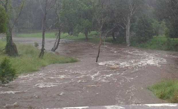 Howards Lane Creek breaks its banks at Alstonville this morning. Photo: Cara Feain-Ryan