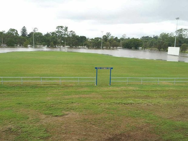 HOPES SUNK: This photo was taken late yesterday morning, with the waters on the rise at Keith Sternberg Oval. By 6pm the entire playing surface was under water.