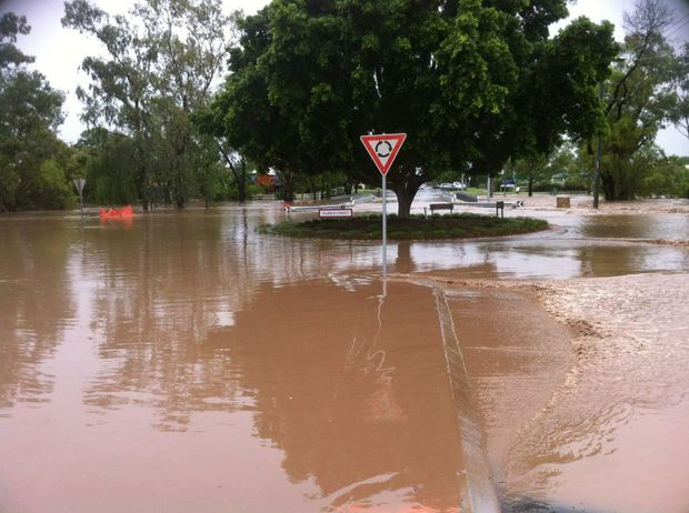 Water over the Patrick St bridge in Dalby where Myall Creek is rising.