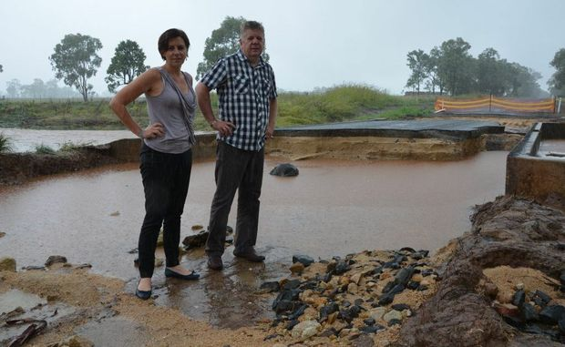 DEVASTATED: Nanango MP Deb Frecklington and mayor Wayne Kratzmann surveyed the damage of Geritz Rd, one of the many damaged in the weekend's floods.