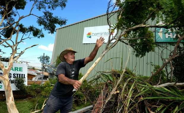 David Millar clears some trees after the storm in Tweed Heads South on Tuesday.
