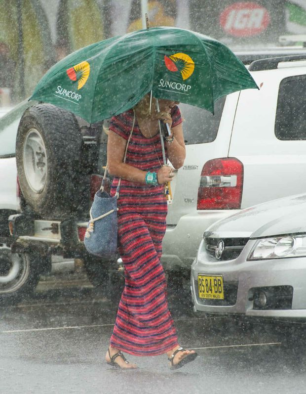 Heavy rain and wind from ex-tropical cyclone Oswald made umbrellas a must-have accessory.