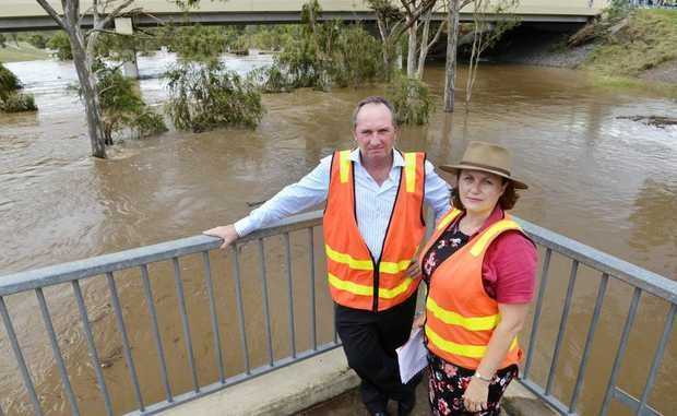 Senator Barnaby Joyce and LNP candidate for Blair Teresa Harding look at the swollen Bremer River at One Mile.