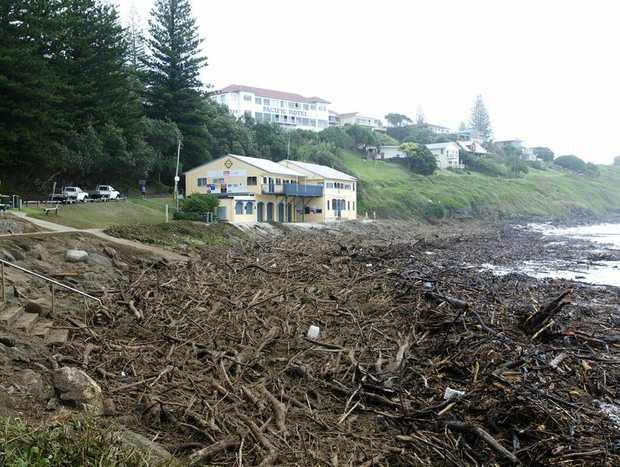 The Yamba Surf Club with debris in front of it on Wednesday. Photo: Lousie Gumb / The Daily Examiner