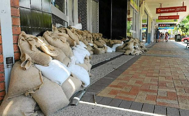 Bourbong St shops were sandbagged against potential flooding of the Bundaberg CBD's main avenue.