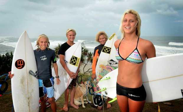 Young board riders Dane Pullinger, Dan Sinclair, Jai Ross, Cedar the dog and Jacinta Greenup in Cabarita Beach.