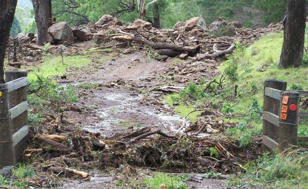 Flood damage to Swanfels Rd near Warwick has cut access to properties in the foothills of the Great Dividing Range.