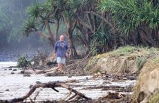 Allen Wise from Fingal Rovers surf club checks out the debris and erosion.
