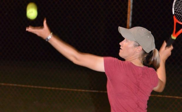 Cassie Kelly proves to have a strong swing during Tuesday night tennis.