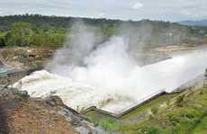 OPEN SEASON: Water is released from the floodgates at Wivenhoe Dam yesterday.