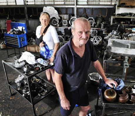 OLD HANDS: Ipswich Transmission Repair owners Jenny and Martin Sangster clean up their flooded premises.