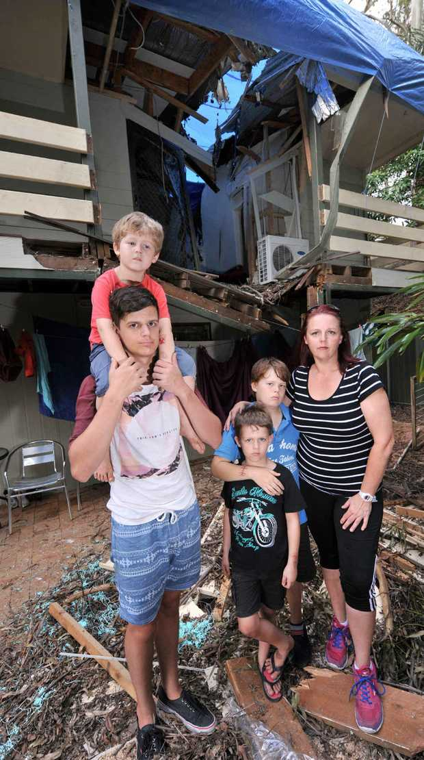A MOOLOOLAH family have found temporary housing after a tree sliced their rental property in two during the weekend's wild weather.