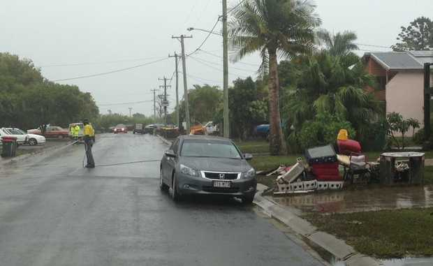 Residents in Bawden Rd put out their flood damaged trash.