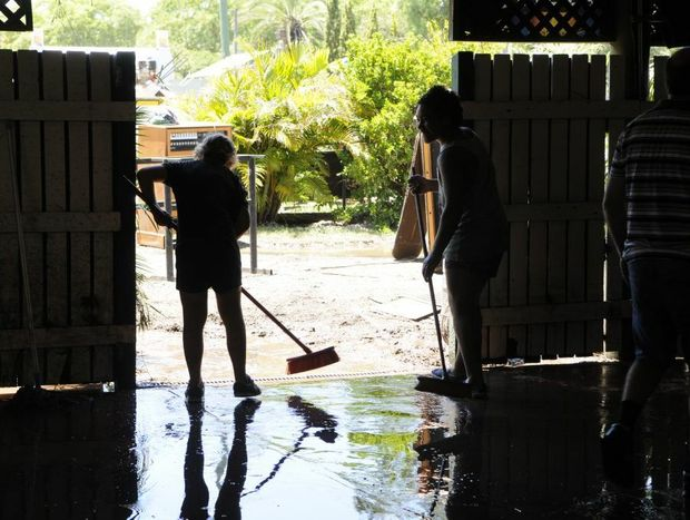 Residents clean up the Laidley Hotel after its sixth - and worst - flood in 25 years.